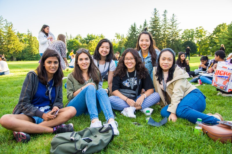 Students sitting in the grass.
